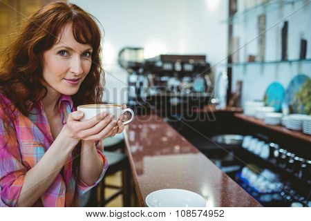 Mature student smiling in cafe at the university