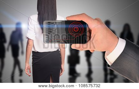 Businessman holding smartphone with x-ray