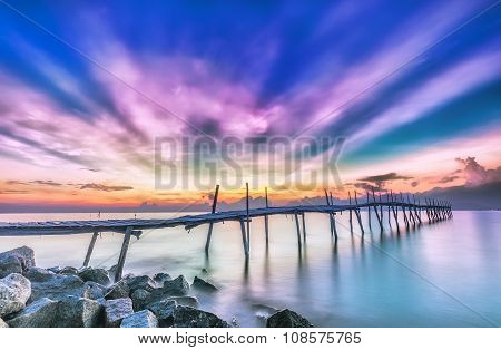 Ray sunrise on a wooden bridge