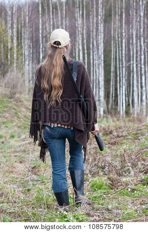 Woman Hunter With Gun Walking In The Forest