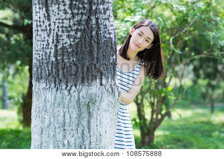Girl Hiding Behind The Trees