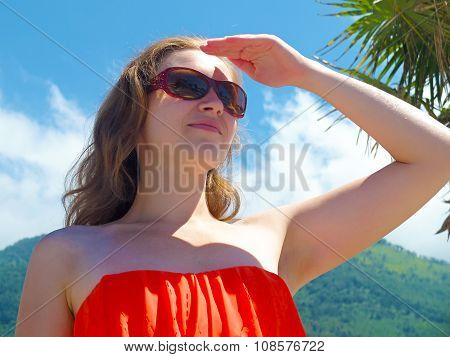 Happy young woman looking for