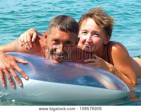 Elderly couple lying on water mattress