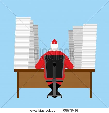 Santa Claus reads letter. Many correspondence from children. Big Pile of letters are on table. Chris