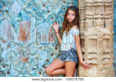 Kid girl tourist in Mediterranean old town door at Spain