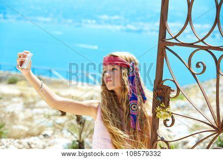 Blond girl selfie photo in mediterranean sea gate at Spain