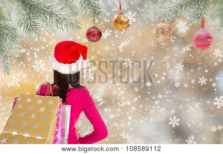 Christmas Shopping. Happy young girl with shopping bags.