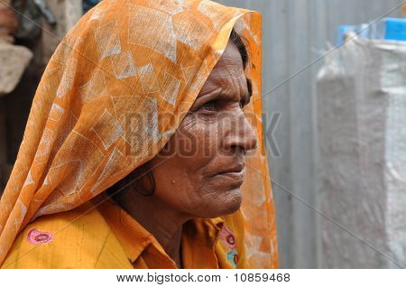 Elderly Lady In India Making Charm Bracelets
