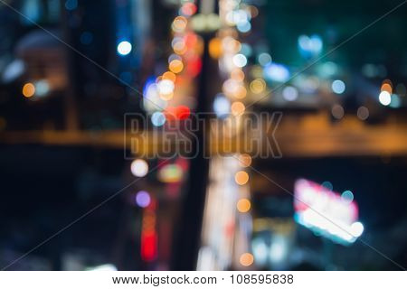 Blurred bokeh city road intersection at night