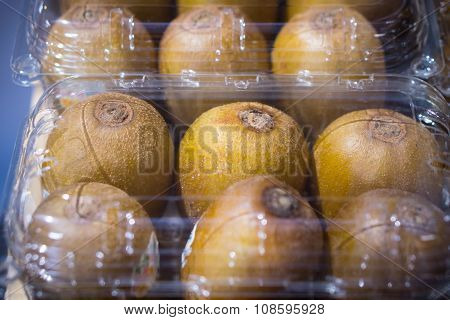 Many Kiwi Fruit In Transparent Plastic