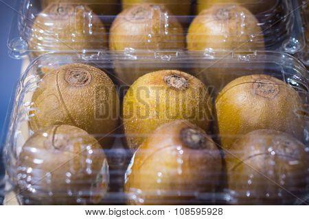 Many Kiwi Fruit In Transparent Plastic