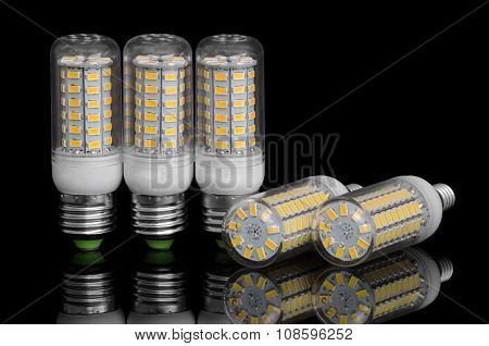 Led Corn Lamp On A Black Background With Reflection