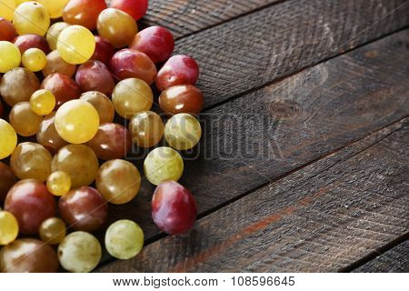 Juicy grapes berries on wooden background