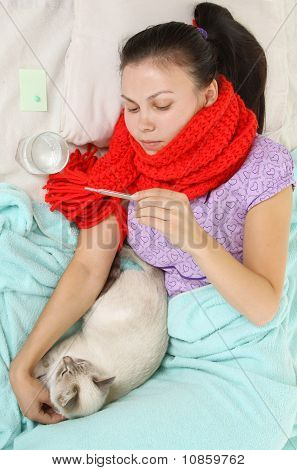 Sick Girl Hugging a Cat and Lying in Bed