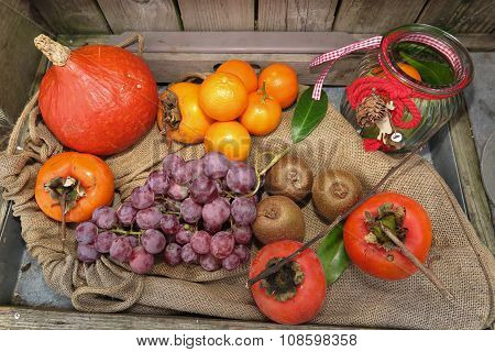 Top View Of Autumn Fruits And Vegetables Under Wooden Background