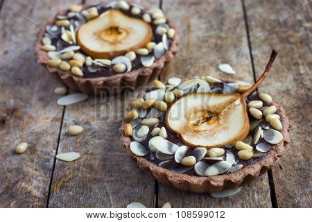 Chocolate Tartlets With Pear And Nuts