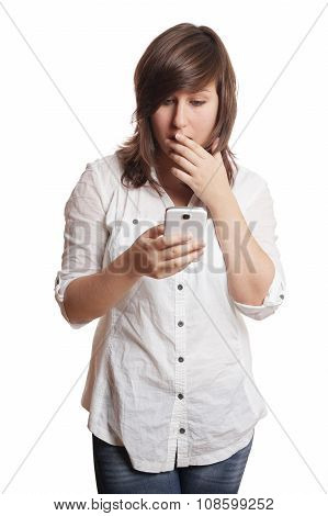 shocked woman staring at smartphone