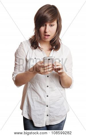 shocked girl staring at smartphone