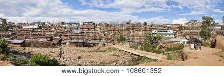 wide panorama of the Kibera slum, largest urban slum in Africa