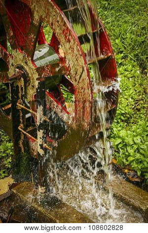 Red Watermill Pouring Water