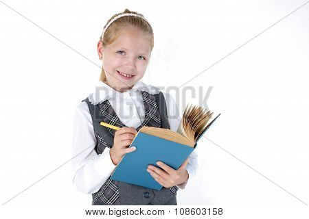 8 Year Old School Girl With Book And Pen Smiling On White Background