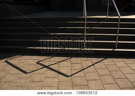 Stairway With Handrail. Light And Shadow.