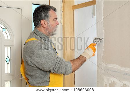 Construction Site, Worker Installing Gypsum Board