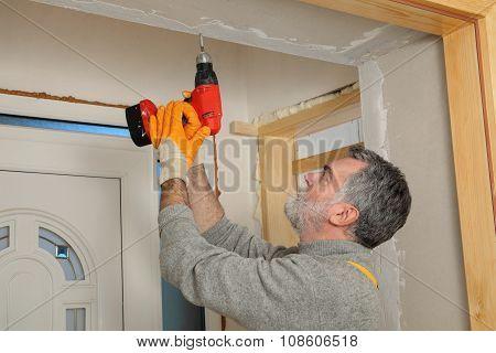 Construction Site, Worker Installing Gypsum Board