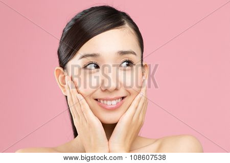 Beautiful asian woman isolated on pink background