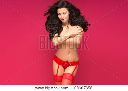Smiling Brunette Woman In Lingerie.