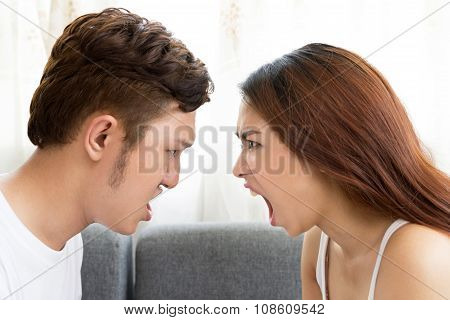 Young Asian couple fighting and shouting