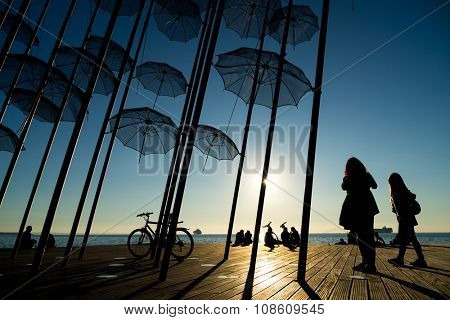 Umbrellas on the waterfront at Thessaloniki, Greece at sunset