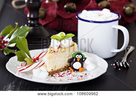 Piece of cheesecake decorated for Christmas