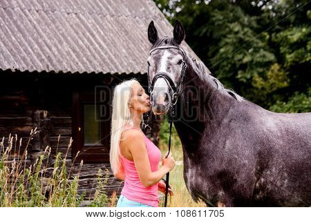 Beautiful Blonde Woman And Her Horse In Rural Area