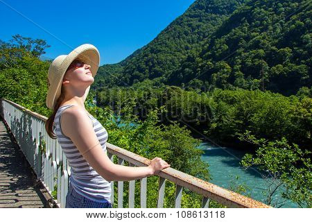 Happy young woman in beige hat