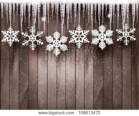 Christmas background with snowflakes and icicles in front of a wooden wall. Vector.