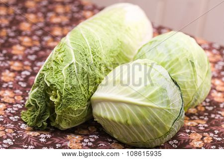 Three Heads Of White And Chinese Cabbage