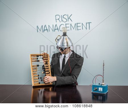 Risk management concept with vintage businessman and abacus