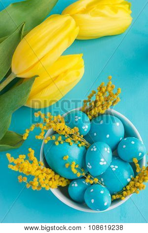 Easter Eggs And Tulips On Blue Background