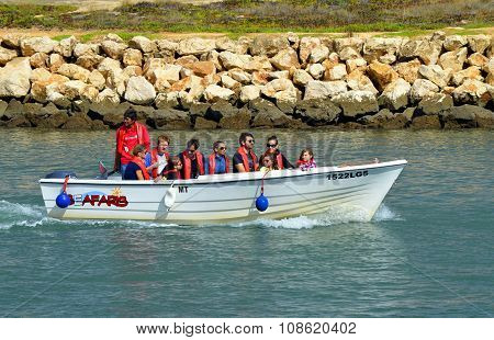 Seafaris motor boat with tourists on the Bensafrim river in Lagos harbour