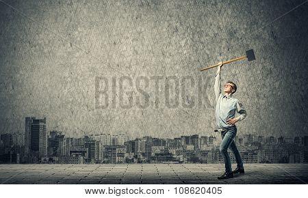 Boy holding hammer