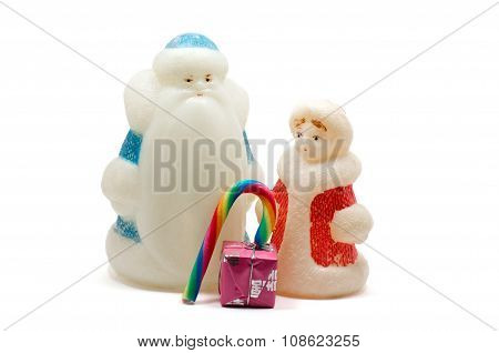 Ded Moroz And Snegurochka With Gift Box And Sweets Over White
