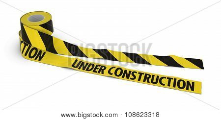 Striped Barrier Tape And Under Construction Tape Rolls Unrolled Across White Floor