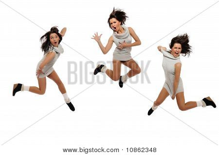 Dynamic Beautiful Wild Winter Woman Jumping And Screaming. Isolated On White Background