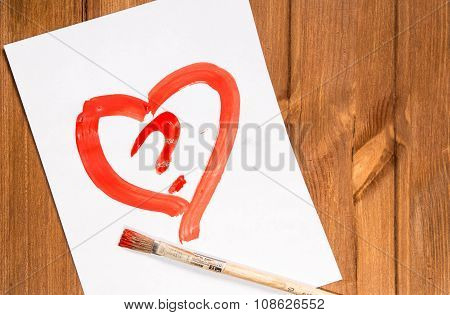 The Heart Drawn With Red Paint On A Clean Sheet Of Paper With A Question Mark In It And ?????? Nearb