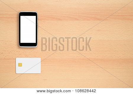 Smart Phone And Credit Card On Office Desk
