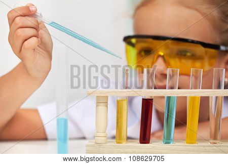 Young student in elementary school science class doing an experiment
