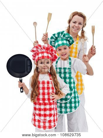 Chefs team ready to cook - kids and their mother holding kitchen utensils