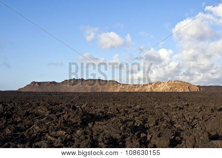 volcanic landscape under the extincted vulcano  under blue sky
