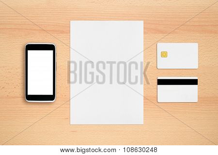 Credit Card, Paper Sheet And Cell Phone On Office Table